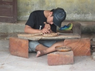 A Vietnamese woodcarver working in Trung Ha Hamlet