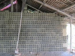Freshly made bricks drying before firing in the kiln. They will shrink during firing.