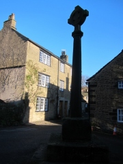 Glossop market cross. The shaft probably dates from C15. It is believed a market has been held here since the 13th century.